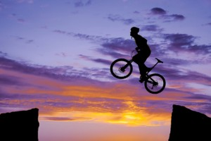 Man on bike jumping silhouette